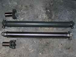 [Old (top) vs. New (bottom) Shorter Drive Shaft; Click to See a Larger Image]